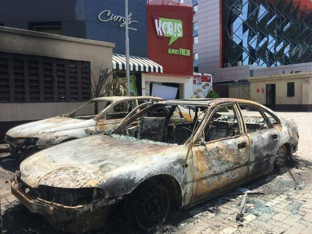 State buildings have been torched  banks and shops destroyed and food shops looted in the Nigerian u...
