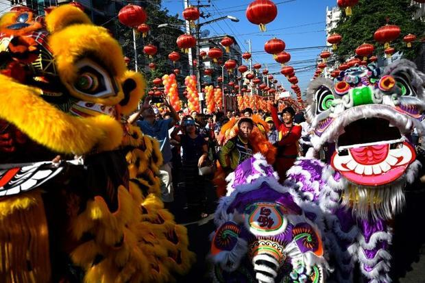 Lion dancers perform during Lunar New Year celebrations in Yangon