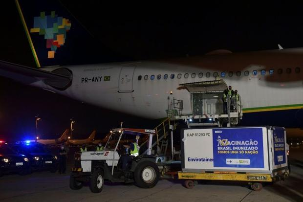 A shipment of the AstraZeneca/Oxford vaccine is unloaded from a cargo plane arriving from India on J...