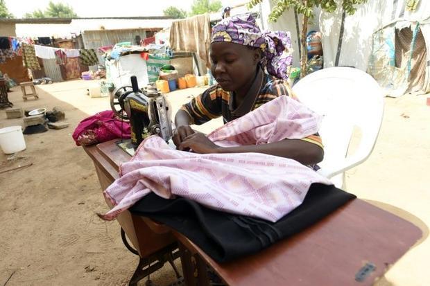 A seamstress sews clothes for internally displaced persons in Maiduguri  northeast Nigeria  on Febru...
