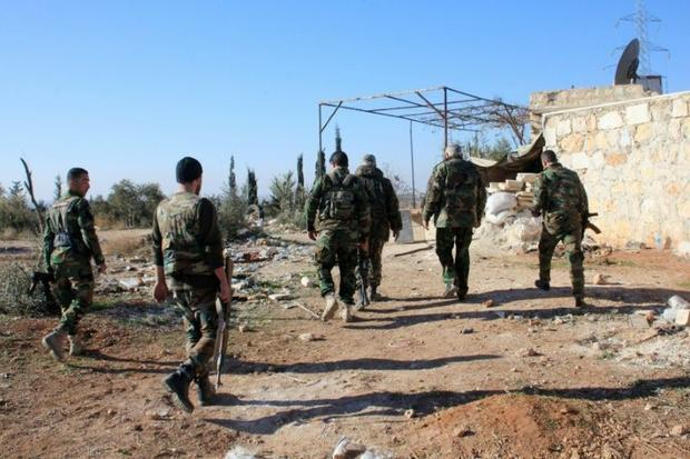 Syrian government forces patrol near Khan Tuman  south of the provincial capital Aleppo  after pro-r...