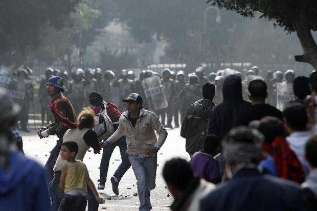Egyptian soldiers clash with protesters near Cairo's Tahrir Square on December 16  2011