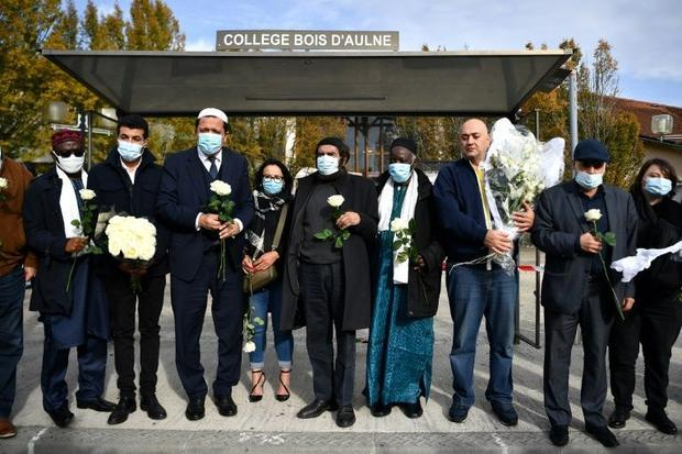 Muslim leaders gathered ouside Paty's school to offer condolences and distance their religion f...