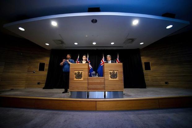 New Zealand Prime Minister Jacinda Ardern and Deputy Prime Minister Winston Peters speak to the medi...