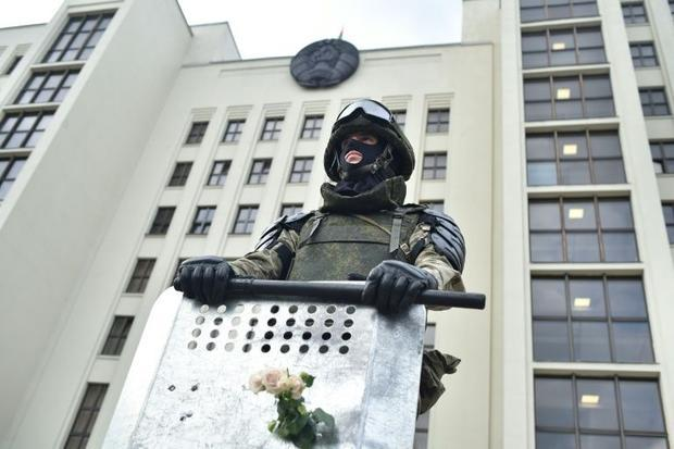 A Belarus' law enforcement officer at an August 14 Minsk rally of opposition supporters who acc...