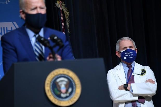 US President Joe Biden (L) appears alongside his top virus expert Anthony Fauci  who says a sense of...