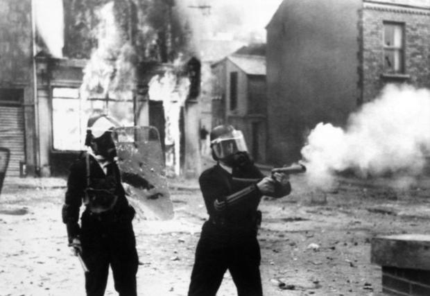 Police fire tear gas at Catholic rioters in Londonderry on August 13  1969  a day before calling for...