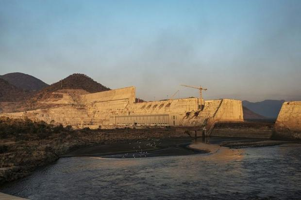 The dam's wall is 145 metres (475 feet) high. Filling the lake that will form behind it will pr...