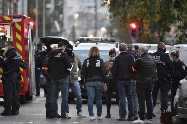 Police investigators in Lyon following the shooting on Saturday