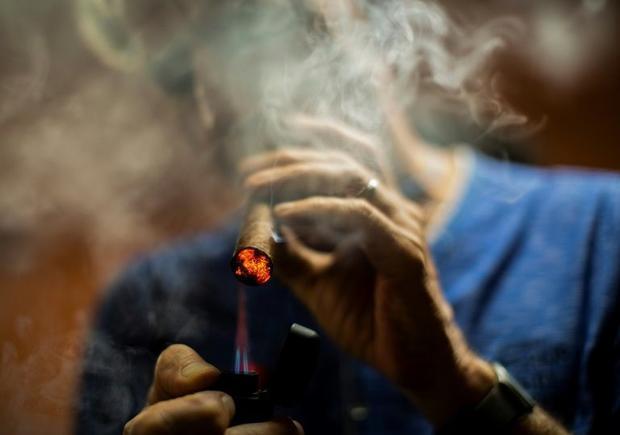 A tourist enjoys a cigar in Esteli