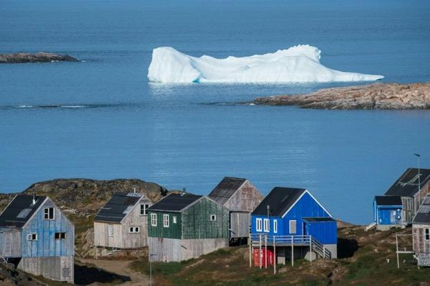 If all of Greenland's ice melted  or were diverted into the ocean as icebergs  the world's...