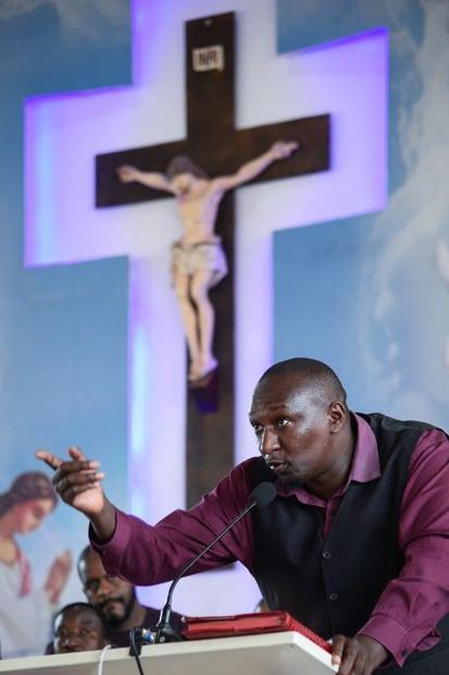 Survivor Alex Niyonzima  shown here speaking at the funeral of one of the victims  recounted how the...