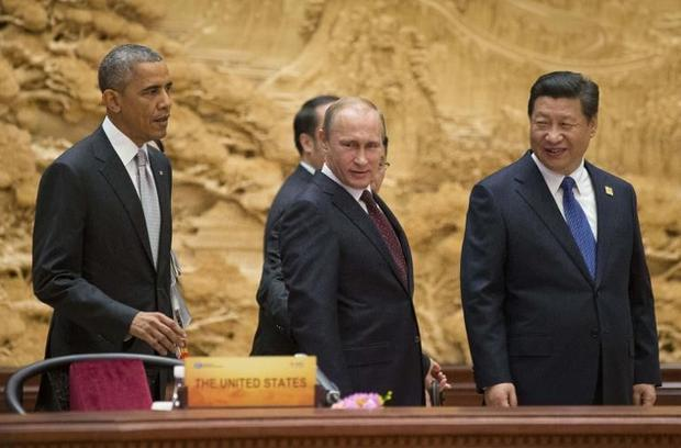 US President Barack Obama  Russian President Vladimir Putin and Chinese President Xi Jinping and arr...