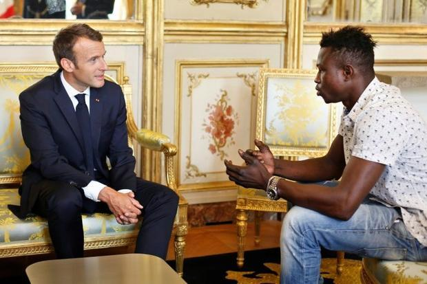 President Emmanuel Macron (left) offers Mamoudou Gassama  22  from Mali  French citizenship after he...