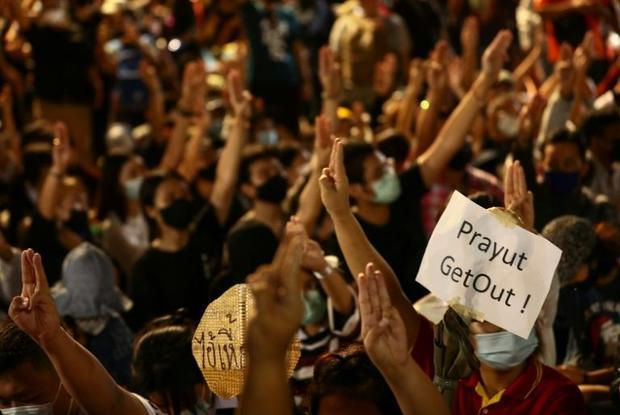 Protesters display a sign calling for the resignation of Thailand's prime minister at a rally i...