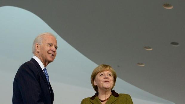 In a flurry of calls  US President-elect Joe Biden (L  pictured 2013) also spoke to German Chancello...