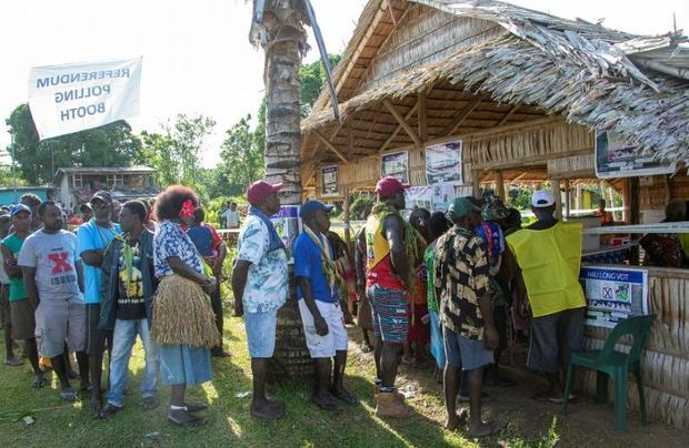 People queue to vote at a polling station in the capital Buka in an historical independence vote on ...