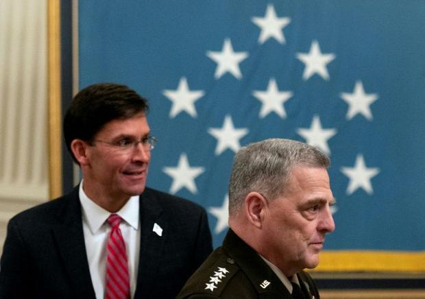 Chairman of the Joint Chiefs of Staff General Mark Milley (right) and then defense secretary Mark Es...