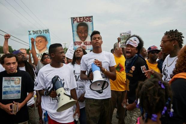 Demonstrators protest during a march of solidarity on West Florissant Avenue  on August 8  2015  in ...