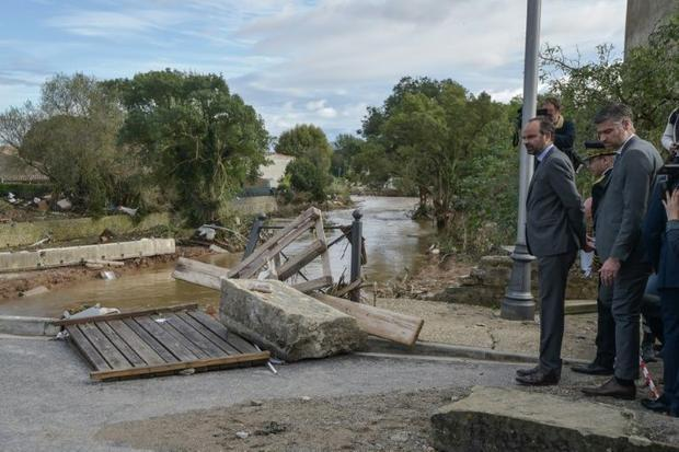 French Prime Minister Edouard Philippe visited the scene  saying the government would press insurers...