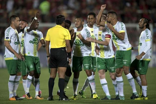 Brazil's Chapecoense players complain about the first Flamengo goal with Peruvian referee Micha...