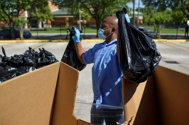 A worker prepares to hand out food in Houston  Texas