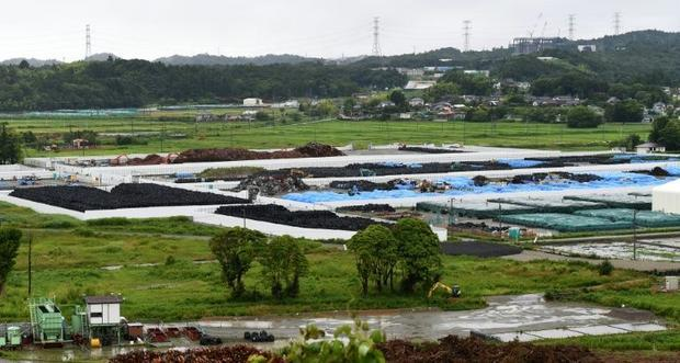 The collection site for contaminated earth in Naraha  a tiny town in Fukushima prefecture  on July 1...