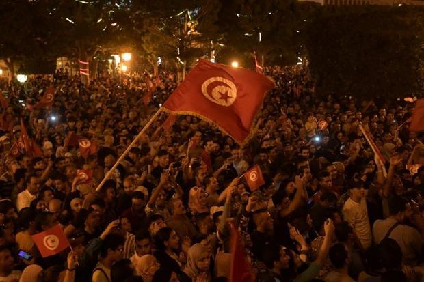 Thousands of people took to the streets of the capital Tunis to celebrate Saied's victory  honk...