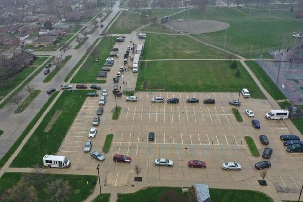 Cars line up at a food bank in Oak Park  Michigan