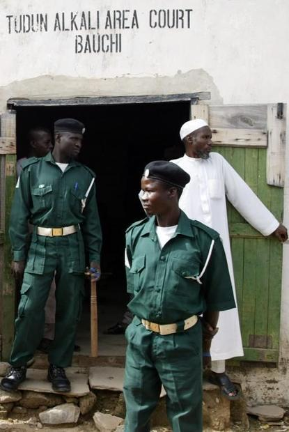 Sharia police otherwise known as HISBAH stand during a court session outside the Tudun Alkali Area S...