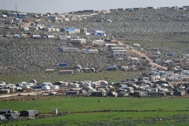 Camps for displaced Syrians along Turkey's border stretch out as far as the eye can see with a ...
