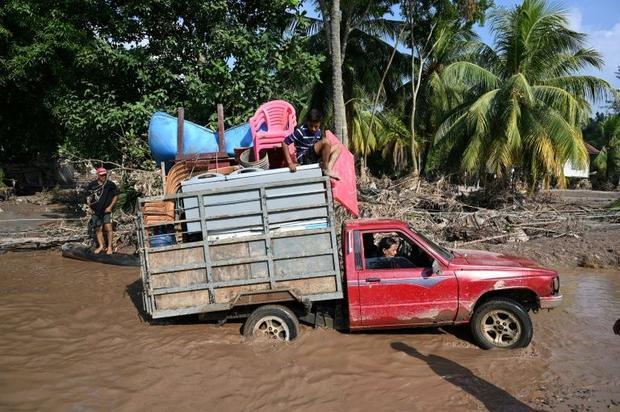 Workers evacuate from a banana plantation near El Progreso  Honduras  ahead of Hurricane Iota  in No...