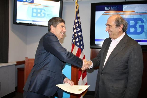 Jeff Shell  Chairman of the Broadcasting Board of Governors  congratulates Andy Lack (L)  after swea...