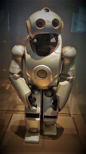 A robot called QRIO on display at the exhibition . designed by Sony.