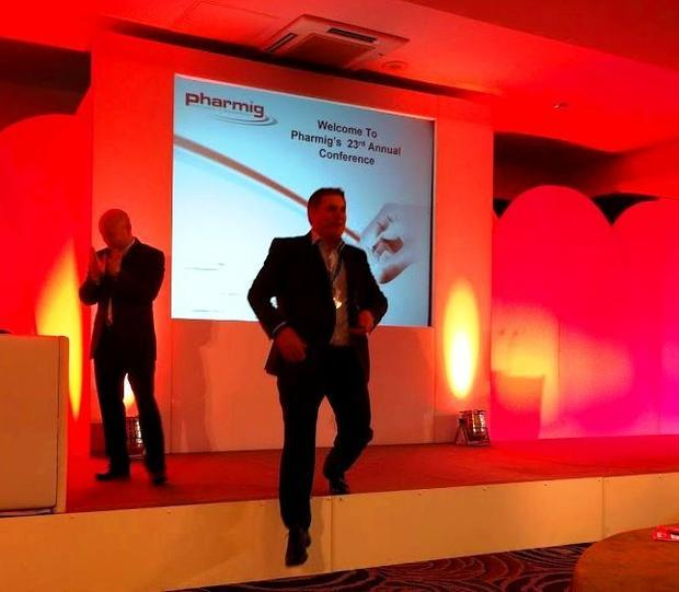 The managing director of Associates of Cape Cod leaves the stage after receiving the exhibitor of th...