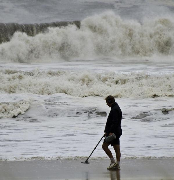 A man looks for treasure during the aftermath of Irene in Monmouth County  NJ