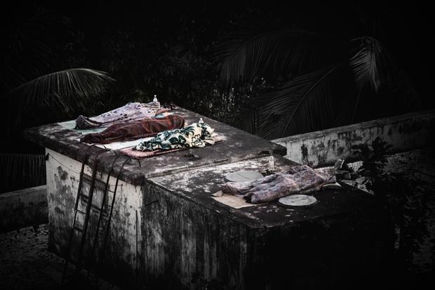 Neighbors sleeping on rooftop.