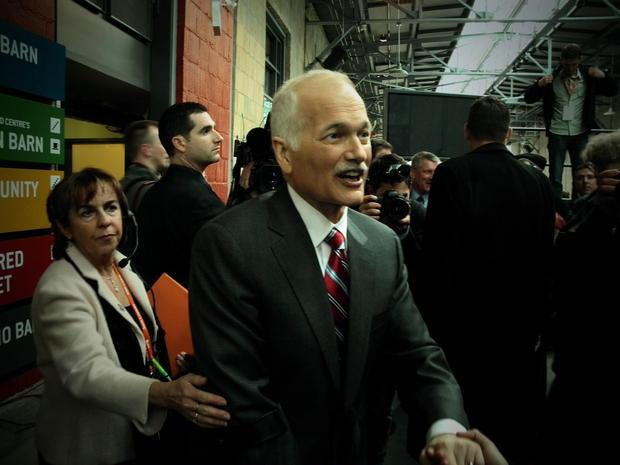 Jack Layton shaking hands with supporters.