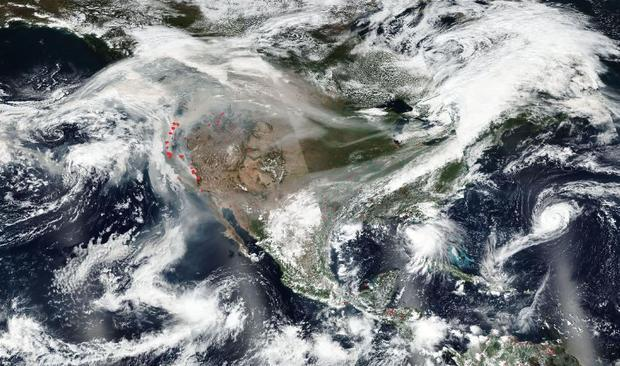 As fires continue to burn in the western U.S.  winds have carried smoke across the continent. Image ...