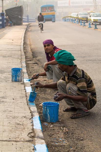 Kolkata  India. Painters working on Dhakuria Bridge.