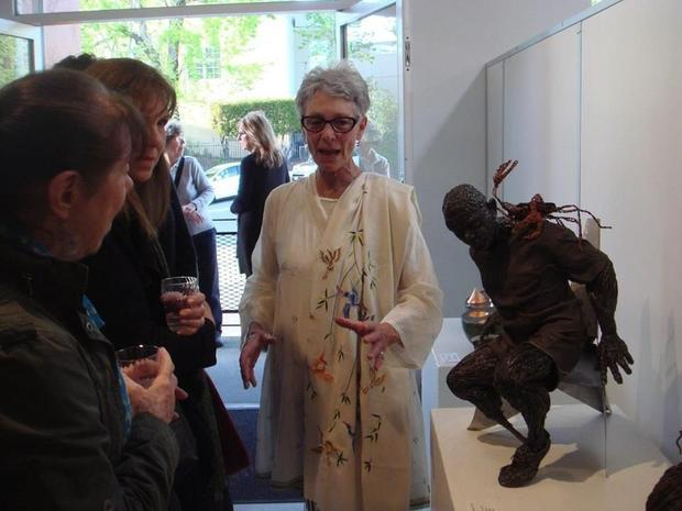 """Seen here at the reception describing her work is sculptor Evany Zirul. Her work is entitled  """"Wil..."""