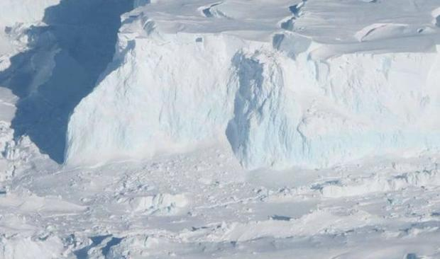Thwaites Glacier s outer edge. As the glacier flows into the ocean  it becomes sea ice and drives up...