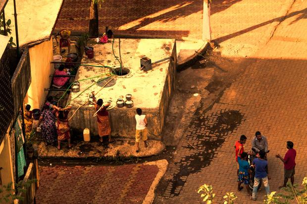 Women filling water from the local tap in Mumbai.