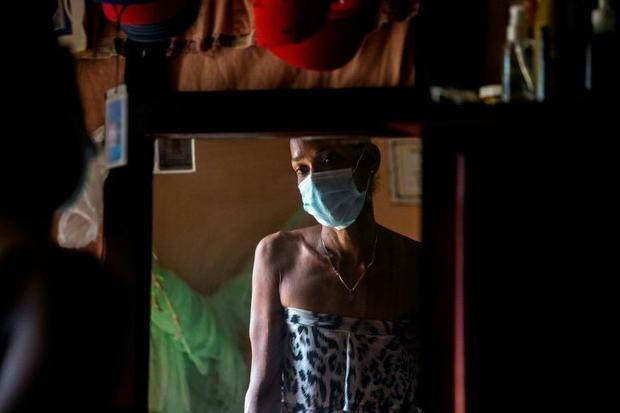 Yohana Espinoza  an HIV-positive transgender prostitute in the Dominican Republic  is seen in her Sa...