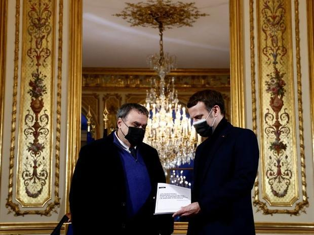 French President Emmanuel Macron (R) meets in January at the Elysee Palace with historian Benjamin S...