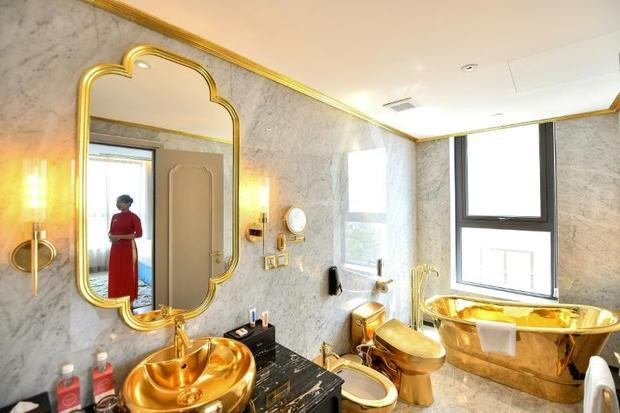 Even shower heads and toilet seats receive the golden treatment