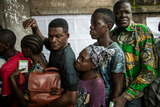 Congolese voters queue outside a polling station during presidential elections in Makelele  Brazzavi...