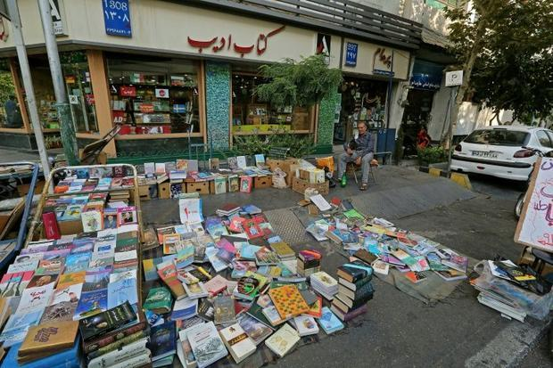 Bookstores stacked with Iranian and foreign titles translated into Persian line both Karim Khan and ...