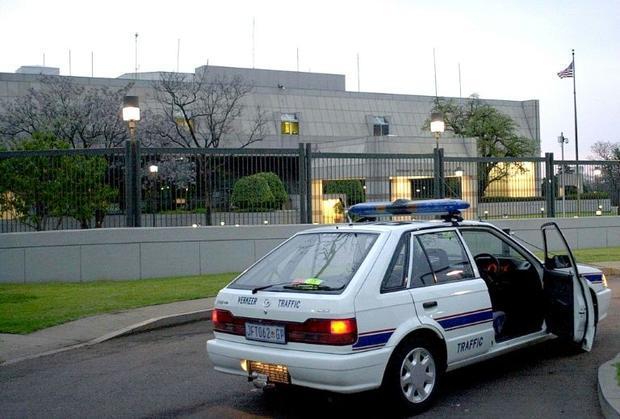 A South African police car is parked September 11  2001 in front of the United States embassy in Pre...