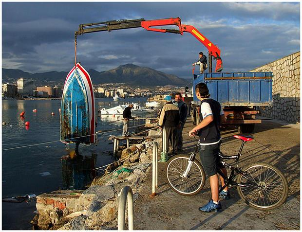 Rescuing sunk boats after a storm  Fuengirola port.